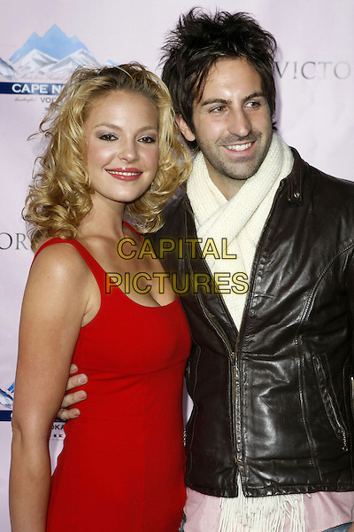 "KATHERINE HEIGL & JOSH KELLEY .Victoria's Secret Angels Karolina Kurkova, Adriana Lima and Selita Ebanks Celebrate The 2008 ""What Is Sexy?"" List, Phoenix, Arizona, USA..February 2nd, 2008.half length red dress married husband wife black leather jacket stubble facial hair white scarf .ADM/MJT.©MJT/AdMedia/Capital Pictures."