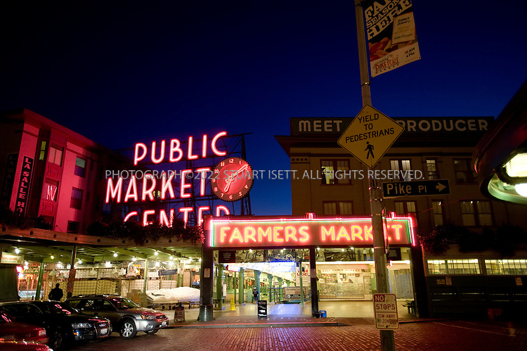 10/10/2008--Seattle, WA, USA..Pike Place Market, where after hours the neon signs illuminate silent stalls dripping with melting ice. ..©2008 Stuart Isett. All rights reserved.