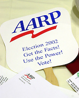 An AARP sign rests on a table during a Pennsylvania 6th Congressional District candidates forum, sponsored by the AARP, Saturday, October 12, 2002, in Malvern, Pa. The forum is one of nine election forums the AARP is hosting throughout Pennsylvania before election day on November 5th. (Photo by William Thomas Cain/photodx.com)