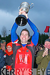 Glenbeigh/Glencar Raymond O'Connor lifts the Michael O'Connor cup after defeating Laune Rangers in the Mid Kerry Championship final in Beaufort on Saturday
