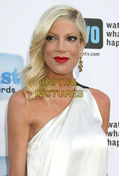 "TORI SPELLING .Bravo's 2nd Annual ""The A-List Awards"" held at The Orpheum Theatre, Los Angeles, CA, USA, 5th April 2009..portrait headshot one shoulder cream white dress red lipstick dyed blonde hair gold earrings .CAP/ADM/MJ.©Michael Jade/Admedia/Capital Pictures"