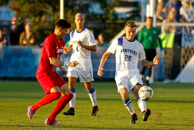 Kentucky junior Kristoffer Tollefsen passes the ball during the Kentucky men's soccer match against Louisville at the Wendell and Vickie Bell Soccer Complex in Lexington, Ky., on Tuesday, September 23, 2014. Photo by Jonathan Krueger | Staff