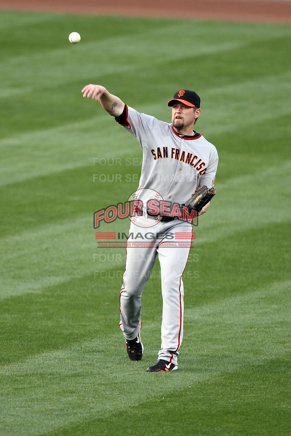 Aubrey Huff #17 of the San Francisco Giants plays the field against the Los Angeles Dodgers at Dodger Stadium in Los Angeles,California on April 3, 2011. Photo by Larry Goren/Four Seam Images