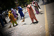 Sweepers sweep the street after Congress party workers celebrated with firecrackers as the results are declared and their party's victory at the Indian general elections outside the All India Congress Committee office in New Delhi, India. .Congress party workers celebrate as the results are declared and their party's victory at the Indian general elections outside the All India Congress Committee office in New Delhi, India. ..The trends reported by state TV showed Congress ahead in 245 seats, the BJP in 160 and the Third Front in 60. Congress supporters are seen celebrating in Delhi.Congress party workers celebrate as the results are declared and their party's victory at the Indian general elections outside the All India Congress Committee office in New Delhi, India. ..India's governing Congress party was headed to a resounding victory Saturday, May 16th 2009 in the monthlong national elections. The trends reported by state TV showed Congress ahead in 245 seats, the BJP in 160 and the Third Front in 60. Congress supporters are seen celebrating in Delhi..