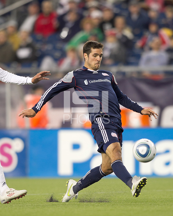 New England Revolution forward Benny Feilhaber (22) flips in disallowed goal. In a Major League Soccer (MLS) match, the New England Revolution defeated the Vancouver Whitecaps FC, 1-0, at Gillette Stadium on May14, 2011.