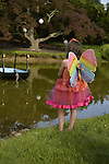 REGAN, 7, of New Jersey, is one of many young girl visitors dressed in fairy costumes to see the Lori Belilove & The Isadora Duncan Dance Company dance throughout the gardens during the Midsummer Night event at the Long Island Gold Coast estate of Old Westbury Gardens on the first day of summer, the summer solstice.