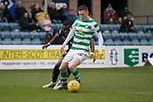 17th March 2019, Dens Park, Dundee, Scotland; Ladbrokes Premiership football, Dundee versus Celtic; Callum McGregor of Celtic holds off Genserix Kusunga of Dundee