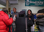 United States President Barack Obama and daughter, Malia, hand out Thanksgiving food to the needy at Bread for the City in Southeast Washington, Wednesday, Nov. 26, 2014.<br /> Credit: Martin H. Simon / Pool via CNP