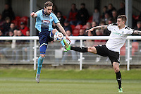 Andy Monkhouse of Grimsby Town (left) battles for the ball during the Vanarama National League match between Dover Athletic and Grimsby Town at the Crabble Athletic Ground, Dover, England on 16 April 2016. Photo by Tony Fowles/PRiME Media Images/PRiME Media Images.