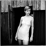 A fashion model poses in front of a barn in the Dutch countryside. These pictures were taken during my travels to Europe.