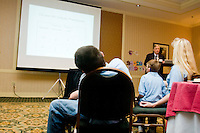 A researcher gives a presentation at the Share and Care Network's annual retreat held at the Doubletree Guest Suites Hotel in Boston on May 20, 2006. <br /> <br /> The Share and Care Network was created in 1981 by Pat Cahill when her son Scott was diagnosed with Cockayne Syndrome.  A rare form of dwarfism, Cockayne Syndrome is a genetically determined condition whose symptoms include microcephaly, mental retardation, progressive blindness, progressive hearing loss, premature aging, and a shortened lifespan averaging 18 years.  Those afflicted have distinctive facial features, including sunken eyes, pinched faces, and protruding jaws as well as distinctive gregarious, affectionate personalities.<br /> <br /> Because of the rarity of the condition (1/1,000 live births) and its late onset (characteristics usually begin to appear only after one year), many families and physicians are often baffled by children whose health begins to deteriorate after normal development.  It was partly with this in mind that the Share and Care Network was formed, to promote awareness of this disease as well as to provide a support network for those families affected.  In 1998 it began organizing an annual retreat, which has grown from three families in its inaugural year to more than 30 today.  Although the retreat takes place in the United States, families from as far as Japan arrive for this one weekend out of the year to share information and to support one another.