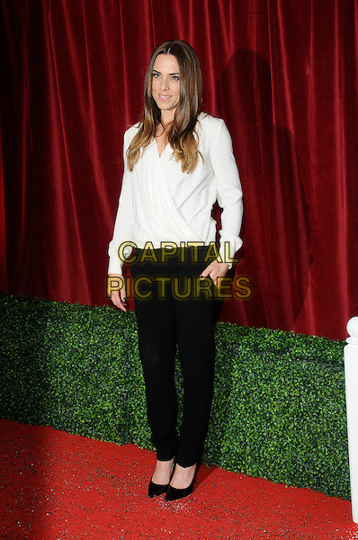 Melanie Chisholm of Spice Girls.Attending the British Soap Awards 2012.at the London Television Centre, London, England, UK, 28th April 2012..arrivals mel c sporty full length black white top shirt trousers hands in shoes christian louboutin in pockets smiling wrap .CAP/CAN.©Can Nguyen/Capital Pictures.