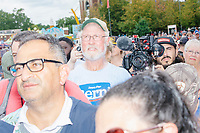 People listen as Democratic presidential candidate Bernie Sanders speaks at the Political Soapbox at the Iowa State Fair in Des, Moines, Iowa, on Sun., Aug. 11, 2019.