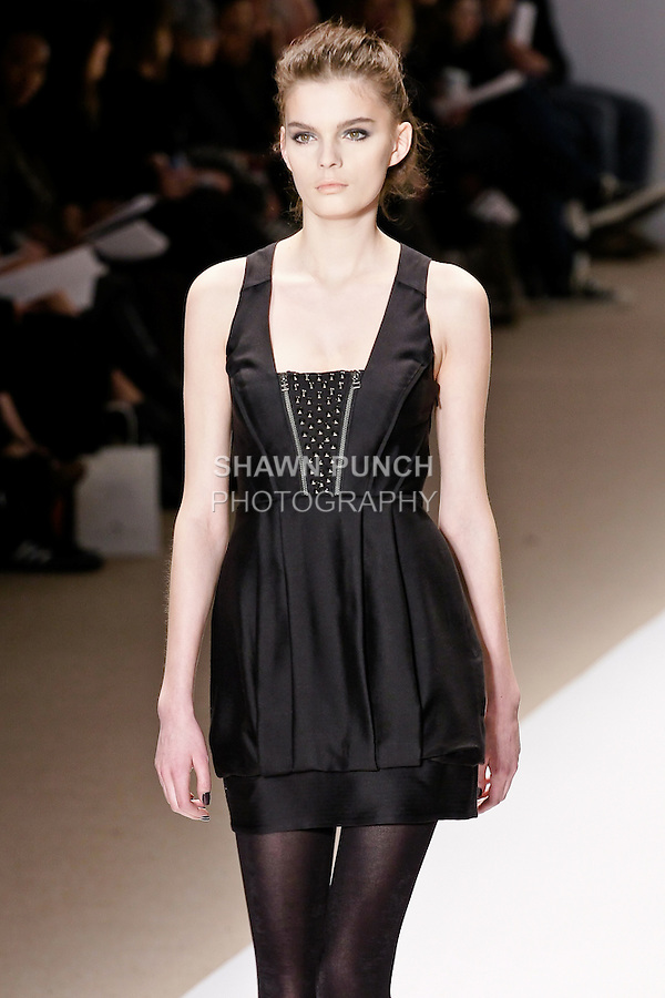 Yulia Terentieva walks the runway in a serenity sleeveless studded dress, and bull dog leash bracelet, by Wenlan Chia, for the Twinkle By Welan Fall 2010 fashion show, during Mercedes-Benz Fashion Week Fall 2010.
