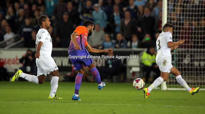 Dael Clichy of Manchester City (C) scores the opening goal during the EFL Cup Third Round match between Swansea City and Manchester City at The Liberty Stadium in Swansea, Wales, UK. Wednesday 21 September.