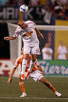 Red Bulls midfielder (13) Clint Mathis heads the ball over Houston Dynamo defender (5) Ryan Cochrane at Giants Stadium, East Rutherford, NJ, on April 21, 2007. Mathis was red carded in the first half.