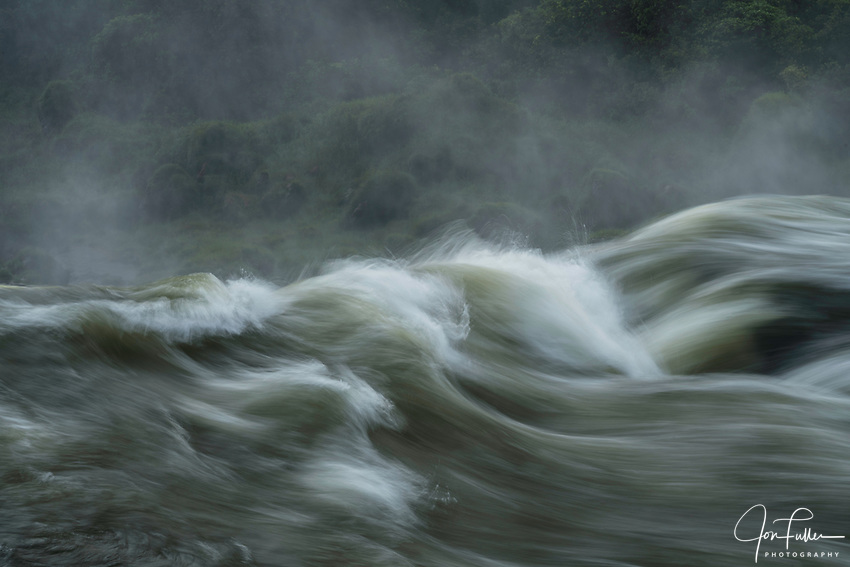 An abstract image of water going over the falls at Iguazu Falls National Park in Argentina.    AU