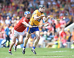 Tony Kelly of Clare in action against Sean O Donoghue of Cork during their Munster senior hurling final at Thurles. Photograph by John Kelly.