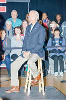 Democratic presidential candidate and former Vice President Joe Biden listens as former Secretary of State John Kerry speaks at a Biden campaign event at The Sports Barn in Hampton, New Hampshire, on Sun., December 8, 2019.