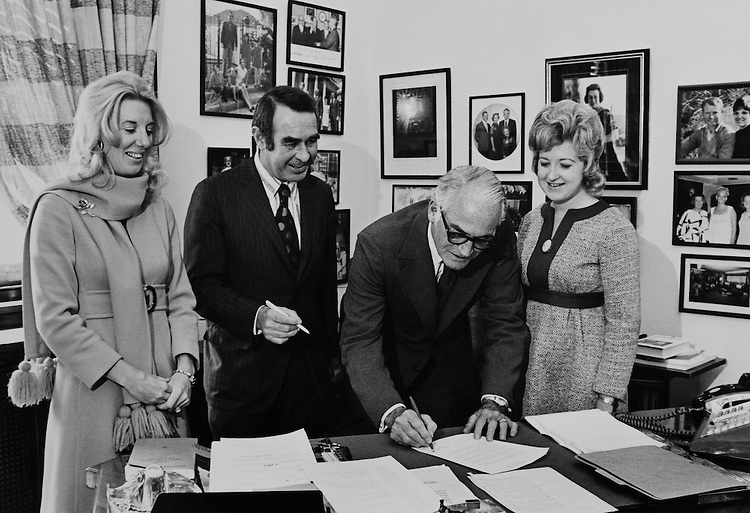 Sen. Barry Goldwater, R-Ariz., Senate Armed Services Committee Chairman, signing a document. (Photo by CQ Roll Call)