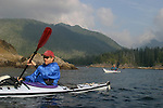 British Columbia, Sea kayakers paddling the Brooks Peninsula, Checleset Bay Ecological Preserve, the wildest part of the west coast of Vancouver Island, Canada, David Fox, Elliot Marks, model released, .