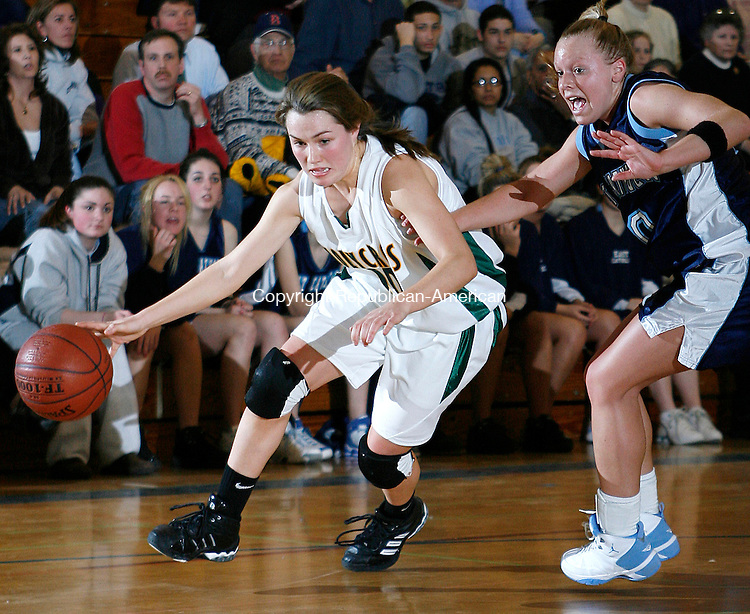 Holy Cross' Kelly McKeon drives against East Catholic's Kristyn Wright lin Class M semi final action at Southington High School Tuesday night.  The Crusaders proceed to the next round with their win over the Eagles 54-5  Michael Kabelka Republican / American.