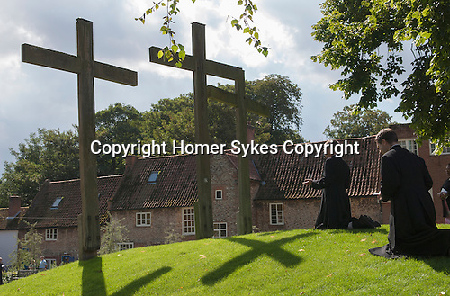 Anglican priests praying In the grounds of The Holy House Englands Nazareth. Little Walsingahm North Norfolk England 2006.