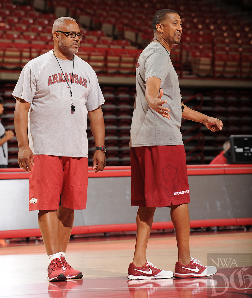 NWA Democrat-Gazette/ANDY SHUPE<br /> Arkansas associate head coach Melvin Watkins (left) and assistant coach Scotty Thurman participate in practice Wednesday, Oct. 5, 2016, in Bud Walton Arena. Visit nwadg.com/photos to see more photos from Media Day and practice.