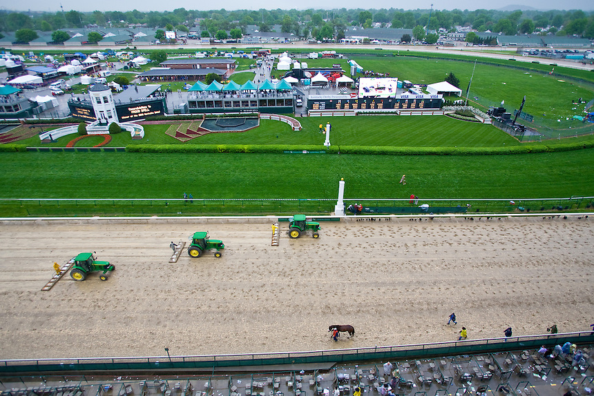 Rain soaks the track at Churchill Downs the day before the Kentucky Derby. The track is designed to drain very quickly and maintenance workers will groom to track to speed the drying process and make the track safe for racing.
