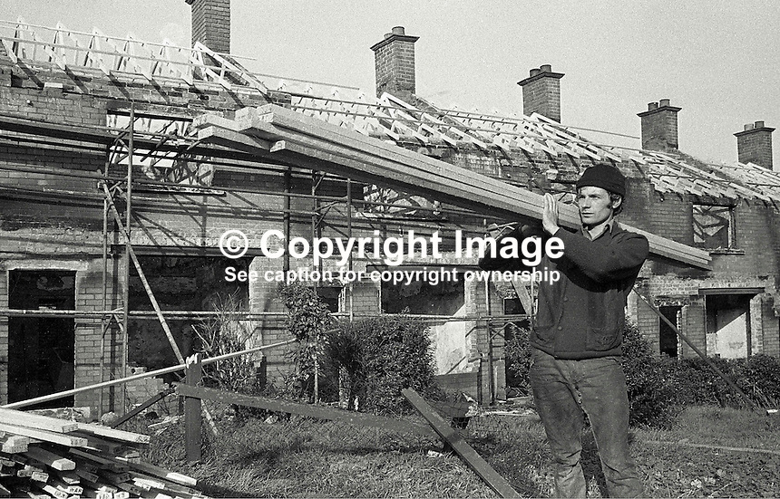 Roman Catholics are rebuilding and making habitable again houses at Farringdon Gardens, Ardoyne, Belfast, which were evacuated and in many cases set on fire by fleeing Protestants who left the area following post-Internment rioting. Date that photos were taken is uncertain but probably 3 or 4 months after the rioting in August 1971. 426/71, 197111000426a...Copyright Image from Victor Patterson, 54 Dorchester Park, Belfast, UK, BT9 6RJ..Tel: +44 28 9066 1296.Mob: +44 7802 353836.Voicemail +44 20 8816 7153.Skype: victorpattersonbelfast.Email: victorpatterson@mac.com.Email: victorpatterson@ireland.com (back-up)..IMPORTANT: If you wish to use this image or any other of my images please go to www.victorpatterson.com and click on the Terms & Conditions. Then contact me by email or phone with the reference number(s) of the image(s) concerned.