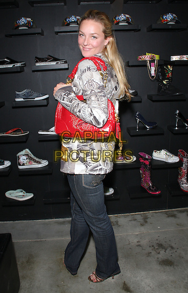 ELISABETH ROHM.Shops at Ed Hardy Outlet, Culver City, California, USA, 8th April 2009..full length jeans logo bag black red silver grey gray print looking back over shoulder .CAP/ADM/KB.©Kevan Brooks/Admedia/Capital PIctures