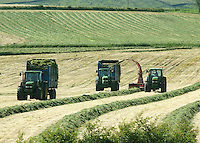 An improvement in the weather over the torrential rain of recent weeks encouraged farmers from around the country to get on with silage making. Wet fields have put operations back by four weeks in some areas. Here it's all systems go near Chipping, Lancashire.
