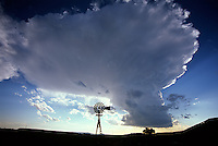 A cumulonimbus cloud forms rapidly above an old windmill located near Capulin New Mexico