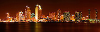 Panoramic of downtown San Diego skyline at night from Coronado Island, California.