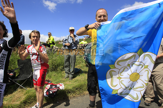 Massive crowds throng the route on the way to the climb of Cote de Cray on Stage 1 of the 2014 Tour de France running 190.5km from Leeds to Harrogate. 5th July 2014.<br /> Picture: Eoin Clarke www.newsfile.ie