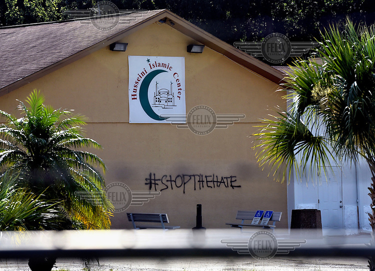 Graffiti sprayed on a wall at the Husseini Islamic Center (a Shia facility), in the aftermath of the mass shooting at the Pulse nightclub, reads: 'Stop the hate'.