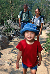 family hike in RMNP, young girl (4yrs) hiking with couple in Rocky Mountain National Park, Colorado, USA