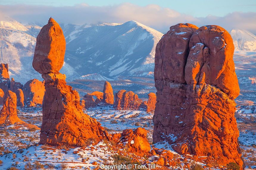Balanced Rock in winter  Arches National Park, Utah  La Sal Mountains beyond    Sunset