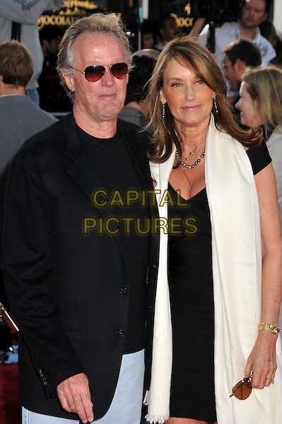 "PETER FONDA & PORTIA REBECCA CROCKETT.""Public Enemies"" 2009 Los Angeles Film Festival Premiere held at Mann's Village Theatre, Westwood, CA, USA..June 23rd, 2009.half length black suit jacket dress white scarf sunglasses shades married husband wife .CAP/ADM/BP.©Byron Purvis/AdMedia/Capital Pictures."