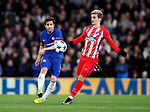 Chelsea's Cesc Fabregas tussles with Atletico Madrid's Antoine Griezmann during the Champions League Group C match at the Stamford Bridge, London. Picture date: December 5th 2017. Picture credit should read: David Klein/Sportimage