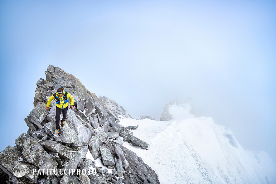 Ueli Steck on an alpine ridge in cloudy weather during his acclimitization process for his climbing expedition to the 8000 meter peak Shishapangma, Tibet
