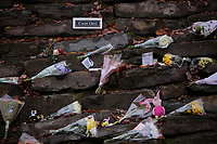Pictured: Flowers and tributes left at the entrance to the lane leading to the house that was burned in a fire in Llangammarch Wells, Wales, UK. Tuesday 07 November 2017<br /> Re: Dyfed Powys Police press conference at Llandrindod Wells over a house fire that killed a father and his children in Llangammarch Wells, mid Wales, UK. <br /> David Cuthbertson, 68, and the children aged between four and 11 are missing, presumed dead, following the blaze.<br /> Three other children aged 10, 12 and 13 escaped and were taken to hospital.<br /> Dyfed-Powys Police said they have been released and are being cared for by family.