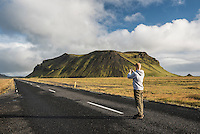 Tourist taking a photo from route 1 near Vik, South Region (Sudurland)
