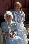 Mother and daughter in pioneer dress on the wagon train for the Oregon Trail Sesquicentennial; Wells Spring, Oregon..#2384-2611