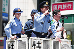 / Police Officers, <br /> Shibuya Scramble crossing after the FIFA World Cup match in Shibuya, Tokyo, Japan. <br /> Japan lost the FIFA World Cup Brazil 2014 Group C match against Cote d'Ivoire.<br /> (Photo by SHINGO ITO/AFLO SPORT) [1195]