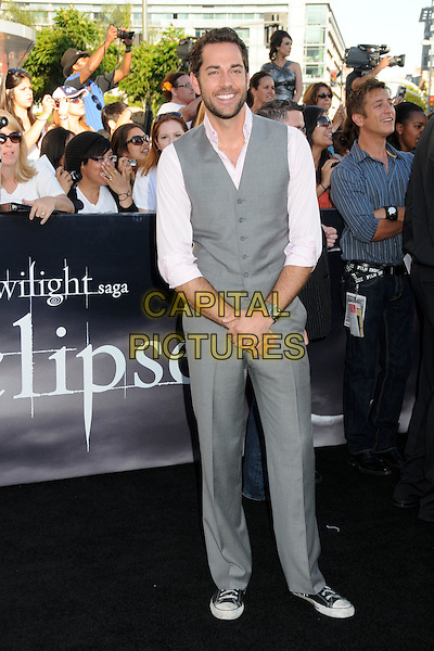 "ZACHARY LEVI .""The Twilight Saga: Eclipse"" Los Angeles Premiere at the 2010 Los Angeles Film Festival held at Nokia Theatre LA Live, Los Angeles, California, USA, 24th June 2010..full length grey gray waistcoat trousers trainers converse pink shirt  beard facial hair .CAP/ADM/BP.©Byron Purvis/AdMedia/Capital Pictures."