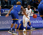 SIOUX FALLS, SD - NOVEMBER 28: Tevin King #2 from South Dakota State University drives against Brandon McKissic #3 from UMKC during their game Wednesday night at Frost Arena in Brookings, SD. (Photo by Dave Eggen/Inertia)