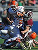 Chris Mixon #33 of Garden City crash lands for a rushing gain in the Nassau County varsity football Conference II final against Carey at Hofstra University on Saturday, Nov. 19, 2016. Garden City won by a score of 42-14.