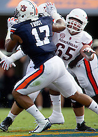 HAWGS ILLUSTRATED JASON IVESTER --08/30/2014--<br /> Arkansas junior offensive guard Mitch Smothers blocks Auburn junior linebacker Kris Frost on Saturday, Aug. 30, 2014, against Auburn at Jordan-Hare Stadium in Auburn, Ala.