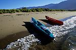 Kayaks beached on the shore Bahia de los Angeles, on Sea of Cortez (Gulf of California), Baja California, Mexico